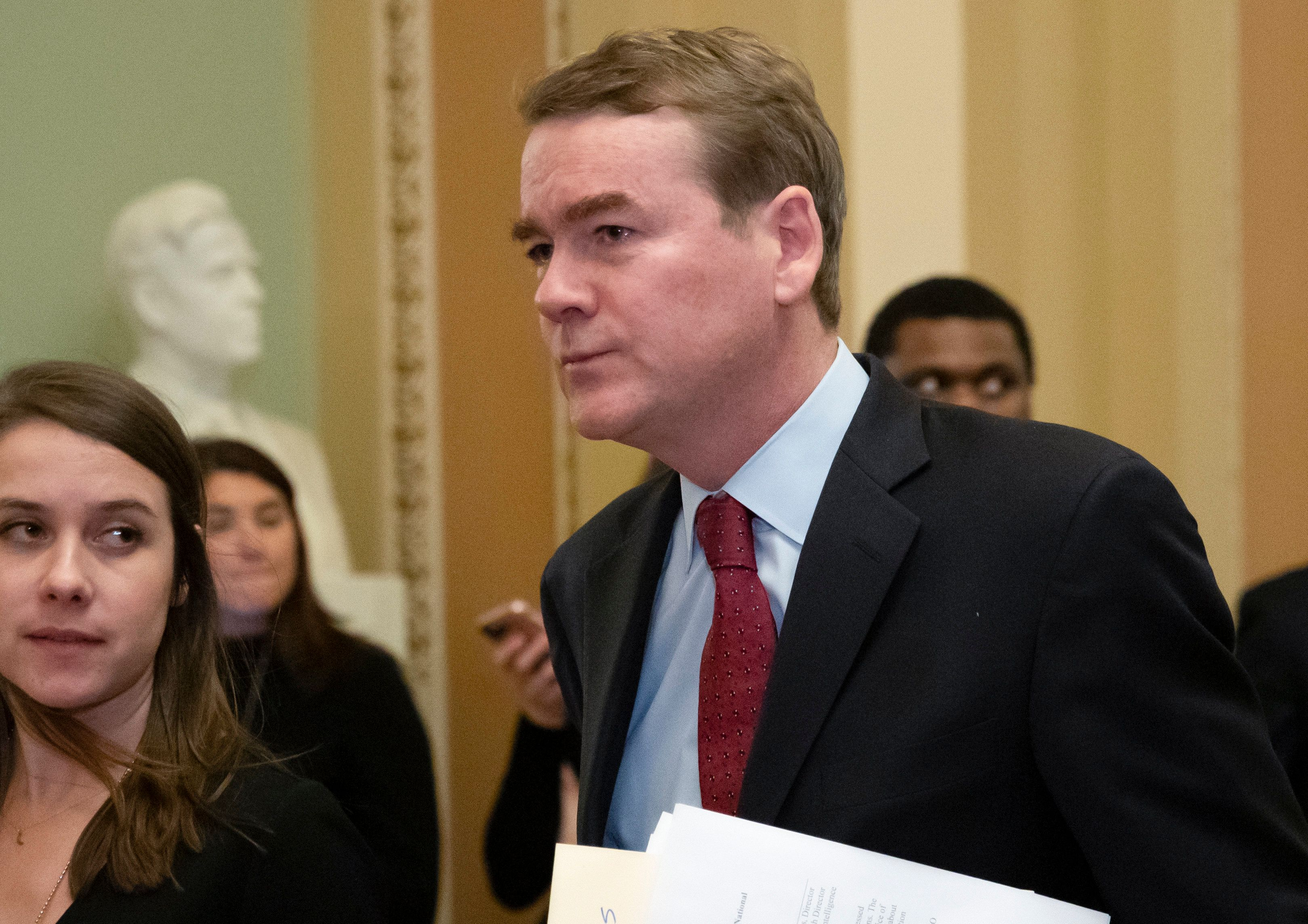 FILE - In this Jan. 24, 2019, file photo, Sen. Michael Bennet, D-Colo., leaves the chamber at the Capitol in Washington. Bennet says he has been diagnosed with prostate cancer as he considers a 2020 Democratic presidential bid (AP Photo/J. Scott Applewhite)