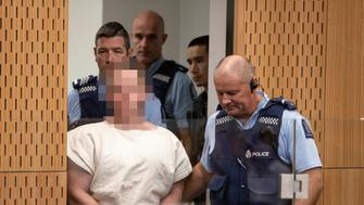 Brenton Tarrant, charged for murder in relation to the mosque attacks, is lead into the dock for his appearance in the Christchurch District Court, New Zealand March 16, 2019.   Mark Mitchell/New Zealand Herald/Pool via REUTERS. ATTENTION EDITORS - PICTURE PIXELATED AT SOURCE. SUSPECT FACE MUST BE PIXELATED. ONLY HIS FACE.