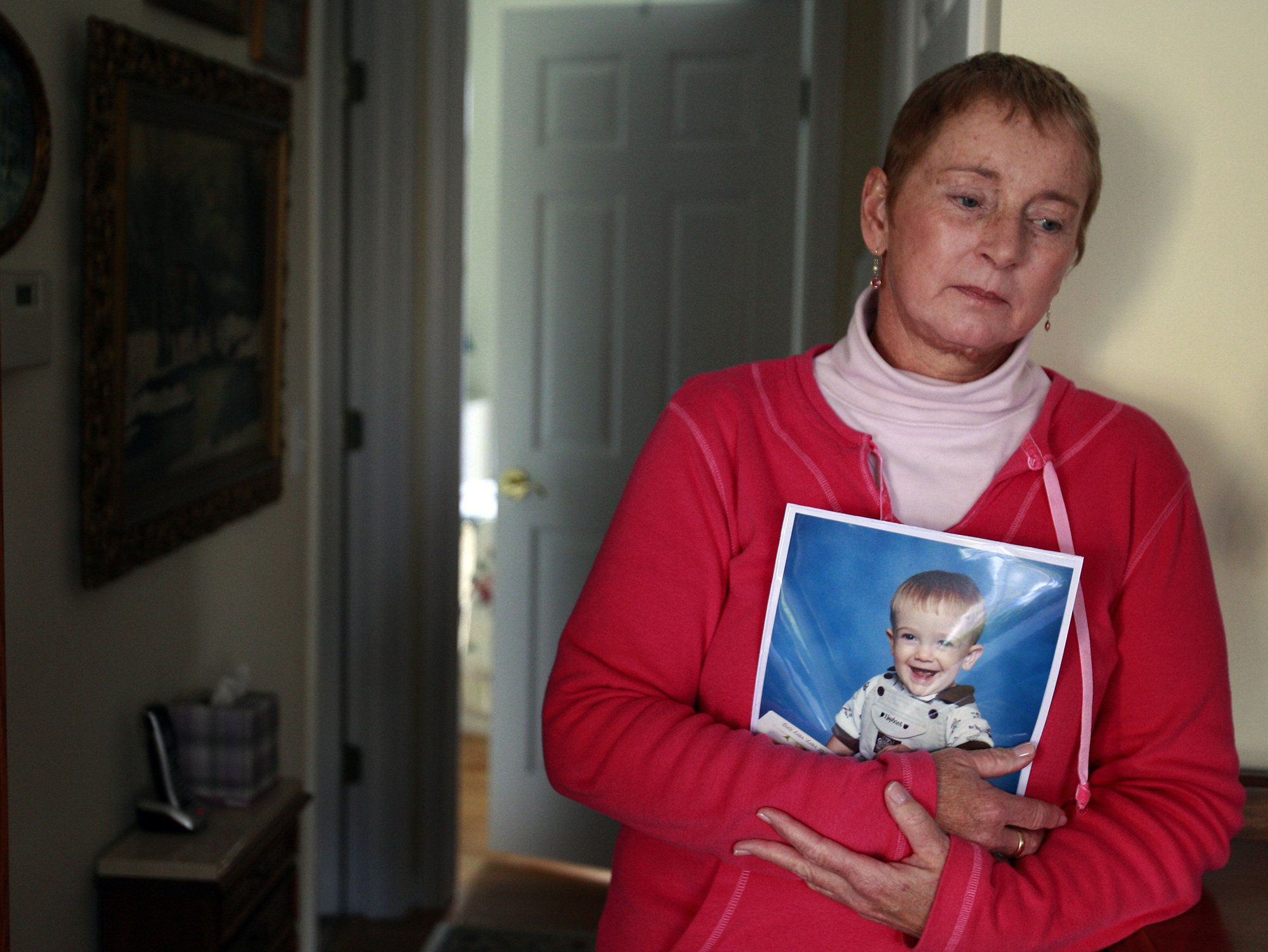 Alana Anderson, mother of Amy Fry-Pitzen and grandmother of Timmothy Pitzen, holding a photograph of her grandson at her home in Antioch, Ill., on November 16, 2011. (Stacey Wescott/Chicago Tribune/TNS via Getty Images)