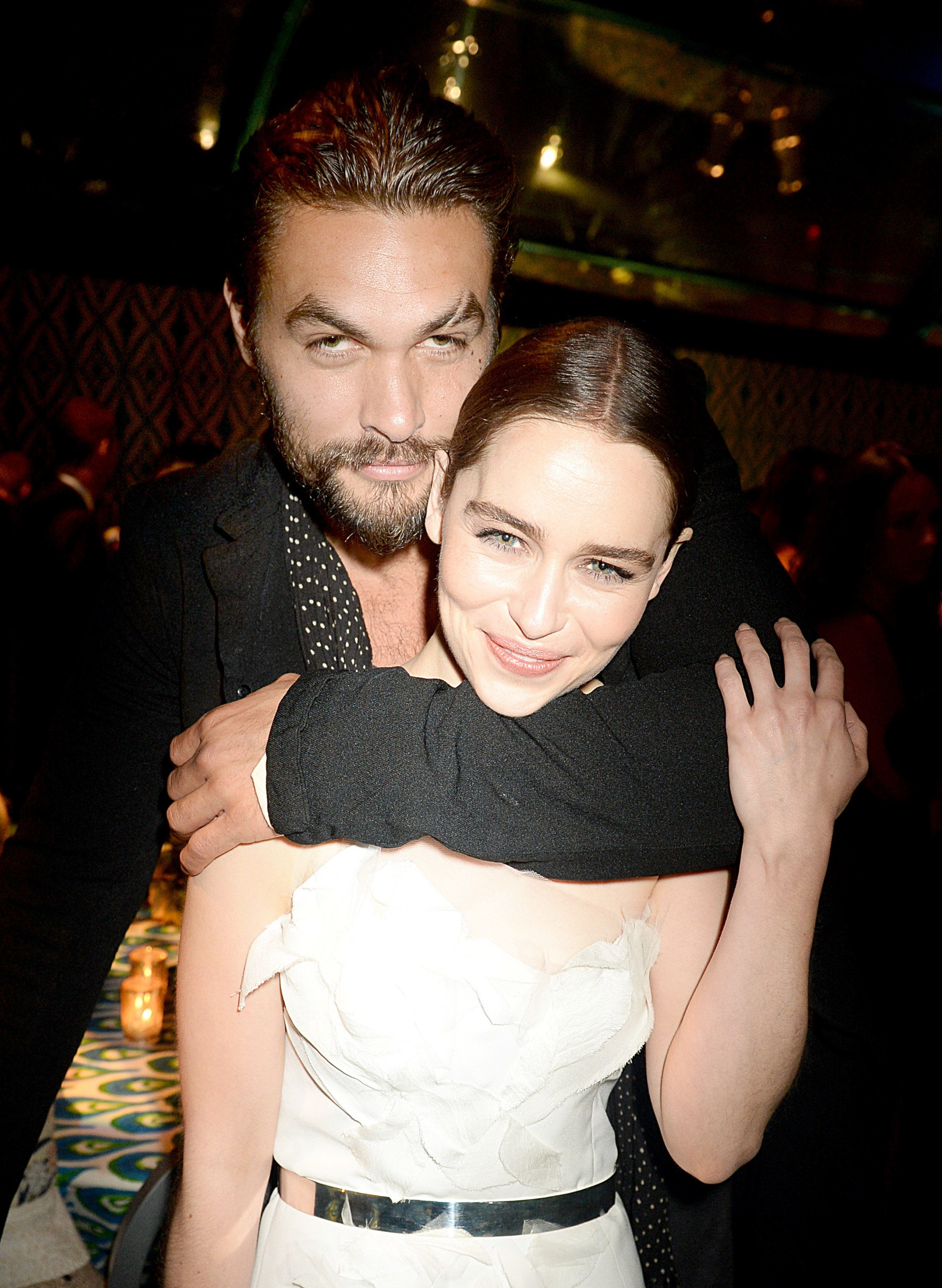 LOS ANGELES, CA - SEPTEMBER 22: Actors Jason Momoa and Emilia Clarke attend HBO's official Emmy after party in The Plaza at the Pacific Design Center on September 22, 2013 in Los Angeles, California.  (Photo by Jeff Kravitz/FilmMagic)