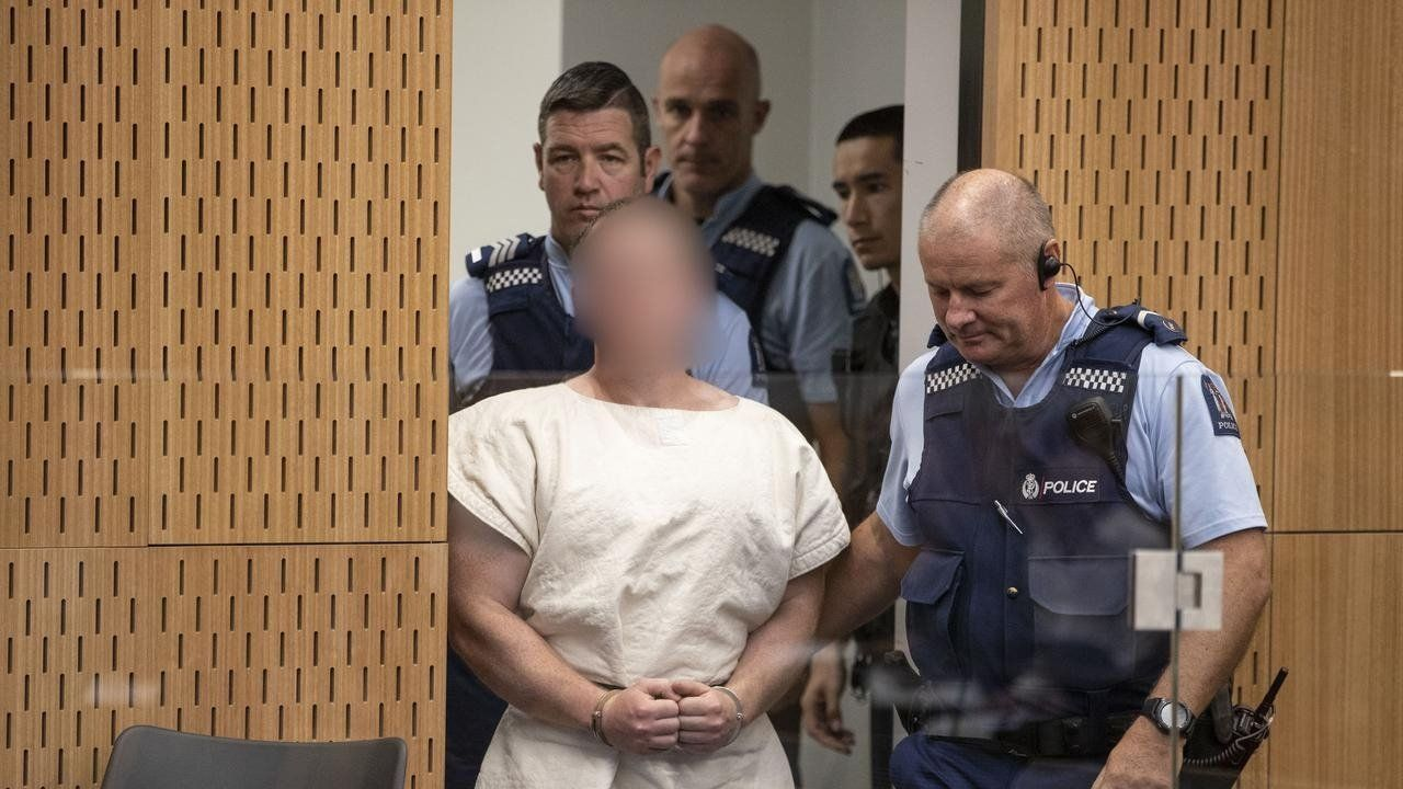 The alleged Christchurch shooter appears at a court hearing in New Zealand.