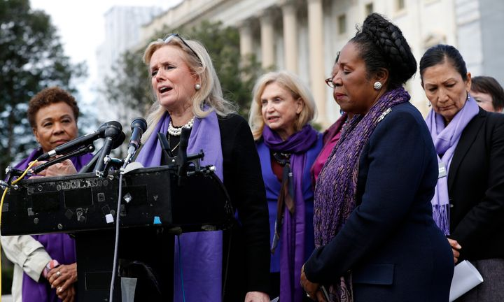 Rep. Debbie Dingell (D-Mich.) leads a news conference with Democratic congresswomen after the House passed legislation to reauthorize the Violence Against Women Act -- without much GOP help.