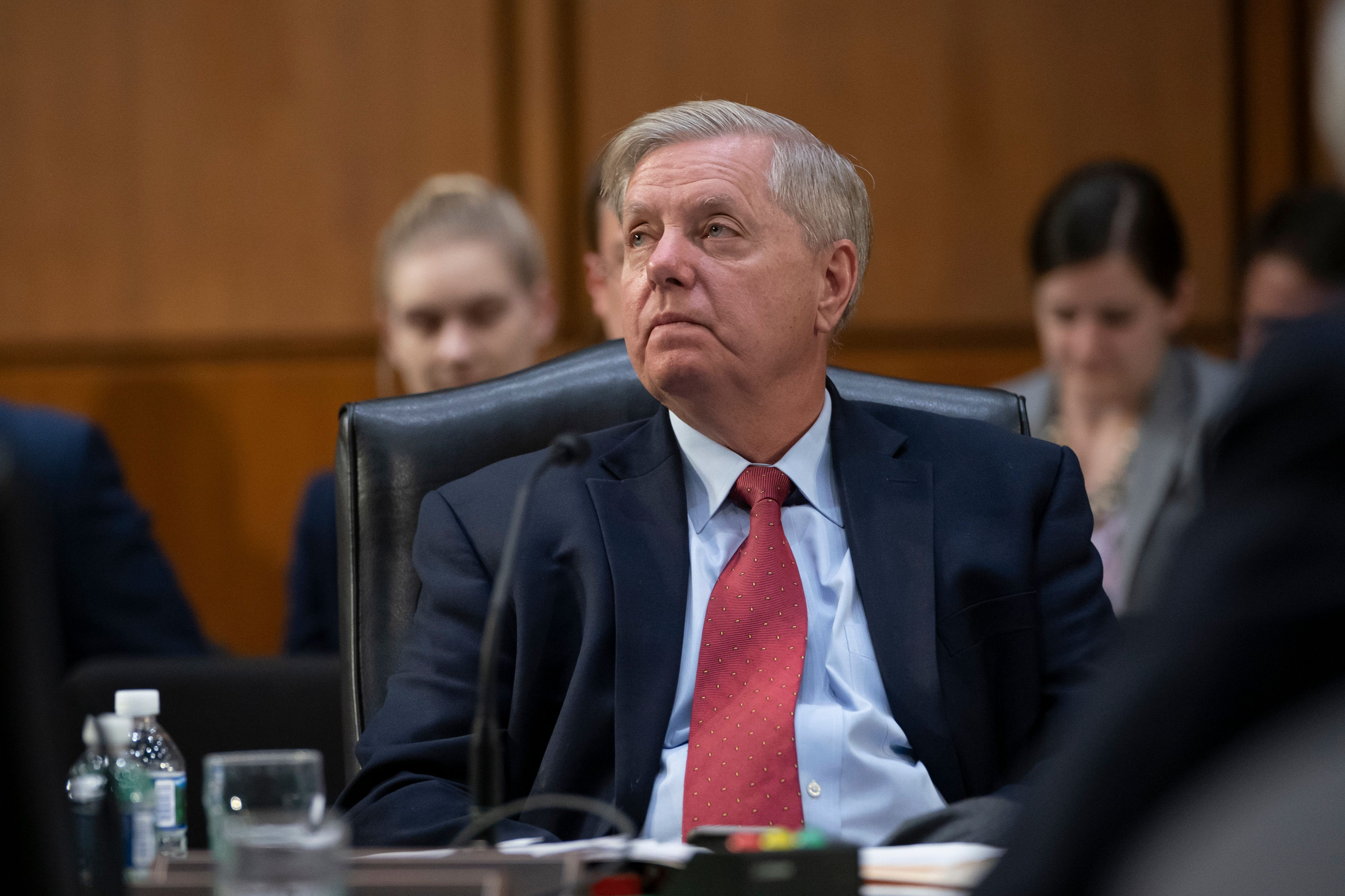 Sen. Lindsey Graham, the Senate Judiciary chairman and ally of President Donald Trump, attends a markup of the federal spending blueprint for fiscal year 2020 with other members of the Senate Budget Committee, on Capitol Hill in Washington, Thursday, March 28, 2019. (AP Photo/J. Scott Applewhite)