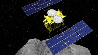 In this computer graphics image released by the Japan Aerospace Exploration Agency (JAXA), the Hayabusa2 spacecraft is seen above on the asteroid Ryugu. Japan's space agency JAXA said Friday, April 5, 2019, its Hayabusa2 spacecraft released an explosive onto an asteroid to make a crater on its surface and collect underground samples to find possible clues to the origin of the solar system. The mission is the riskiest for Hayabusa2, as it has to immediately get away so it won't get hit by flying shards from the blast. (ISAS/JAXA via AP)