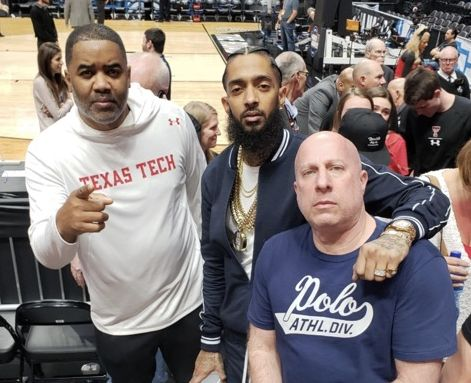 Nipsey Hussle poses with Bobby Francis and former manager Steve Lobel last Saturday at the Texas Tech-Gonzaga Elite Eight game. (via Bobby Francis)