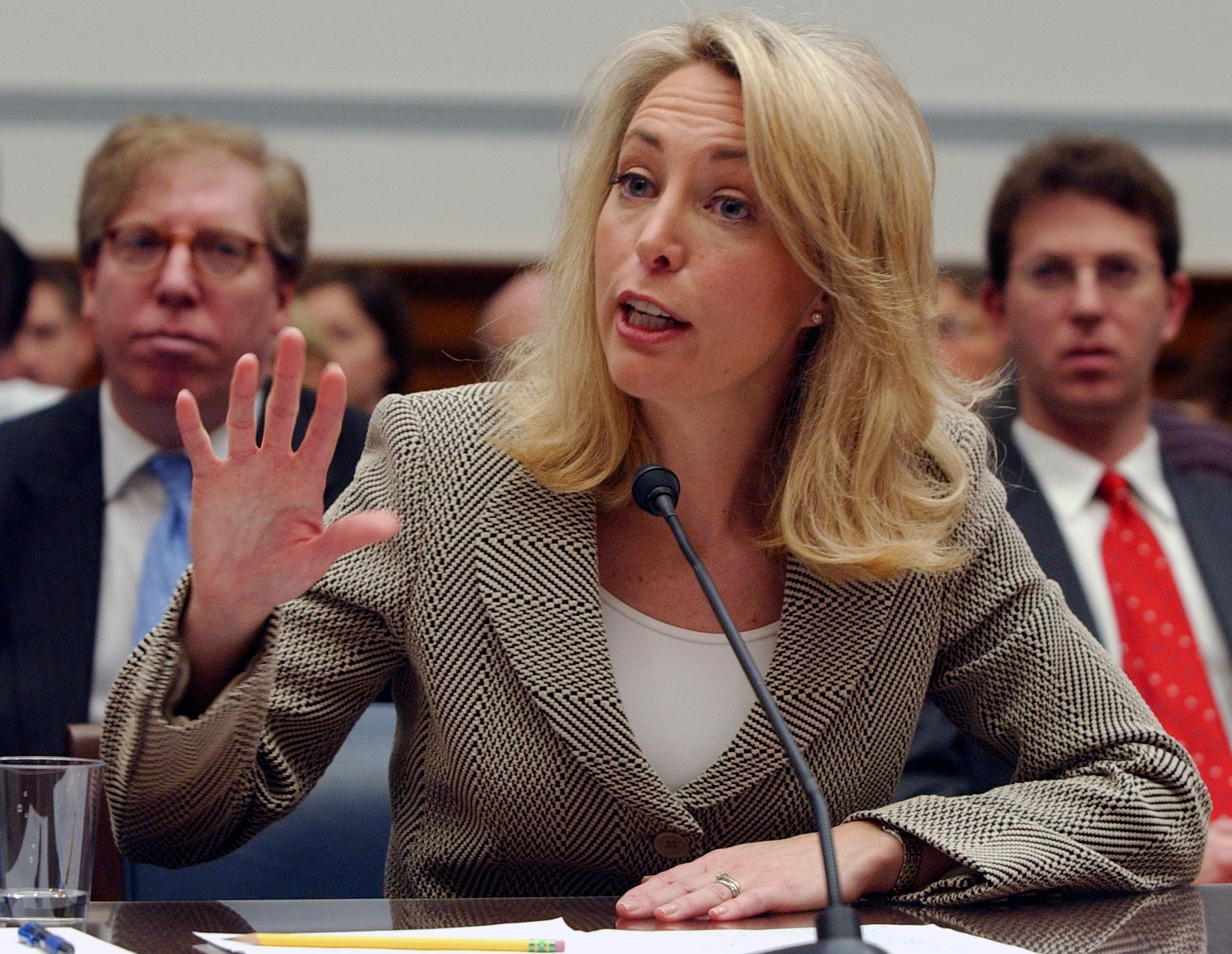 FILE- In this March 16, 2007 file photo, former CIA operative Valerie Plame gestures while testifying on Capitol Hill before the U.S. House Oversight and Government Reform Committee. The former CIA operative told The Associated Press on Friday, April, 5, 2019, she is considering a run for an open U.S. Congressional seat in New Mexico. (AP Photo/Dennis Cook)