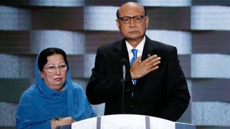 FILE - In this July 28, 2016, file photo, Khizr Khan, father of fallen Army Capt. Humayun Khan and his wife Ghazala speak during the final day of the Democratic National Convention in Philadelphia. Many Muslim Americans cringe at the way they have been portrayed by candidates during the presidential campaign, either as potential terrorists or as eyes and ears who can help counterterrorism efforts. Those descriptions have been offered by Donald Trump and Hillary Clinton, respectively. And they trouble Muslims who complain they are being pigeonholed and their concerns on other issues ignored. (AP Photo/J. Scott Applewhite, File)