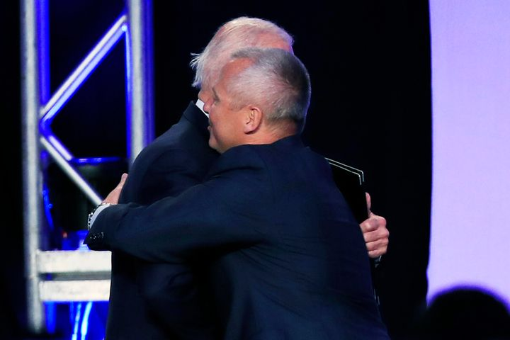 Former Vice President Joe Biden and union leader Lonnie Stephenson exchange a consensual hug.