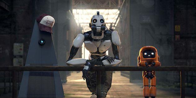 Cena do bem-humoradoOs Três Robôs, episódio baseado em um conto do escritor...
