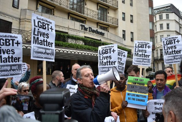 Human rights campaigner Peter Tatchell addresses crowds outside London's Dorchester Hotel on