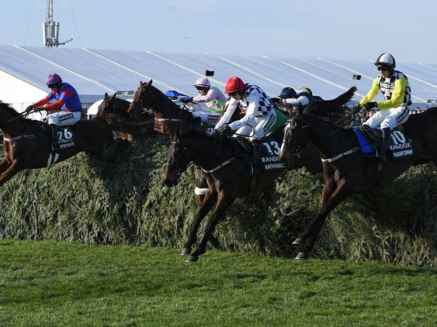 Horses compete in Saturday's Grand National race at Aintree,