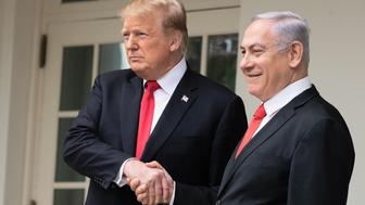 WASHINGTON, DC - MARCH 25: U.S. President Donald Trump and Prime Minister of Israel Benjamin Netanyahu walk through a colonnade prior to an Oval Office meeting at the White House March 25, 2019 in Washington, DC. Netanyahu is cutting short his visit to Washington due to a rocket attack in central Israel that had injured seven people at White House on March 25, 2019 in Washington, DC. (Photo by Drew Angerer/Getty Images)