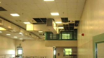 In this undated photo provided by the Prison Law Office, a non-profit public interest law firm that provides free legal services to prison inmates, is a dining hall where damaged ceiling tiles have been removed at the California Substance Abuse Treatment Facility and State Prison in Corcoran, Calif. California is spending $260 million over four years to repair leaking roofs and clear dangerous mold that imperils more than two dozen deteriorating prisons. An inmate lawsuit over the conditions says the repairs aren't moving fast enough. (Prison Law Office via AP)