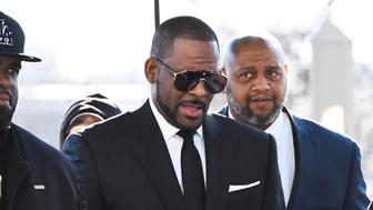 R. Kelly arrives at the Leighton Criminal Court for a hearing on Friday, March 22, 2019, in Chicago. (AP Photo/Matt Marton)