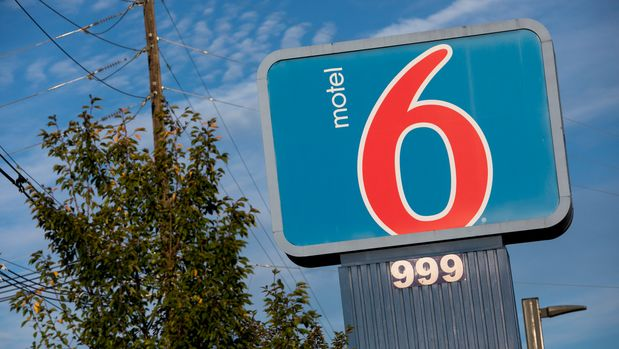 A logo sign outside of a Motel 6 location in Frederick, Maryland on September 23, 2017. Photo by Kristoffer Tripplaar