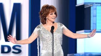 LAS VEGAS, NEVADA - APRIL 07: Host Reba McEntire speaks onstage during the 54th Academy Of Country Music Awards at MGM Grand Garden Arena on April 07, 2019 in Las Vegas, Nevada. (Photo by Kevin Winter/Getty Images)