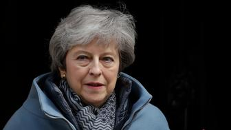 British Prime Minister Theresa May leaves 10 Downing Street in London, to attend the weekly Prime Minister's Questions at the Houses of Parliament, Wednesday, April 3, 2019. With Britain racing toward a chaotic exit from the European Union within days, May veered away from the cliff-edge Tuesday, saying she would seek another Brexit delay and hold talks with the opposition to seek a compromise. (AP Photo/Matt Dunham)