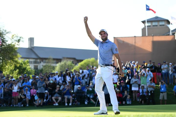 Corey Conners celebrates after winning his first PGA tournament.
