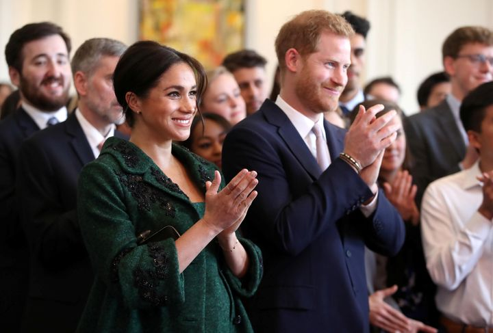 The Duke and Duchess of Sussex applaud after a Commonwealth Day youth event at Canada House in London on March 11, 2019.