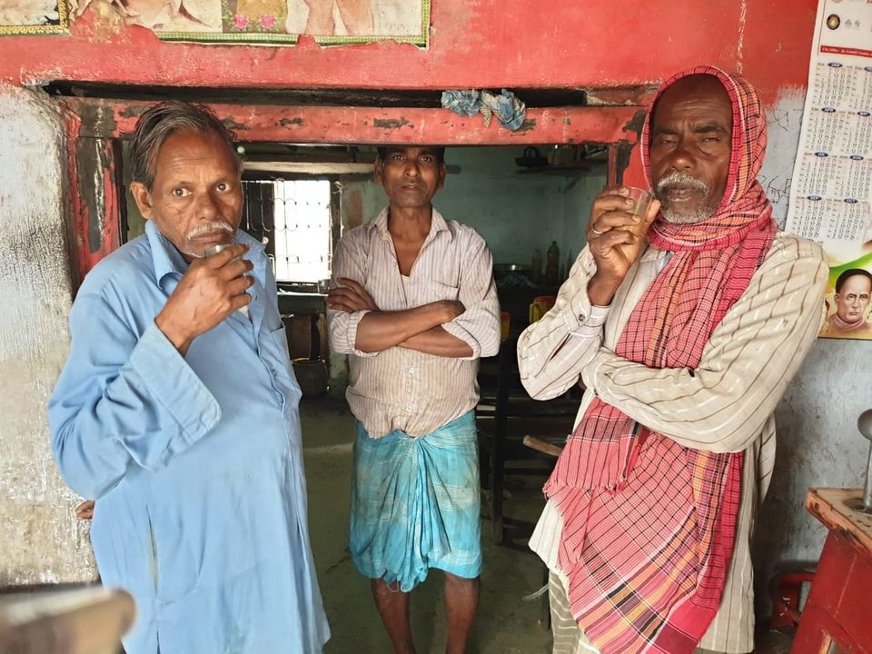 Ghulam Mohammad (centre) at his tea