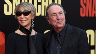 """Tania Kosevich, left, and Eric Idle arrive at the Los Angeles premiere of """"Snatched"""" at the Regency Village Theater on Wednesday, May 10, 2017. (Photo by Jordan Strauss/Invision/AP)"""