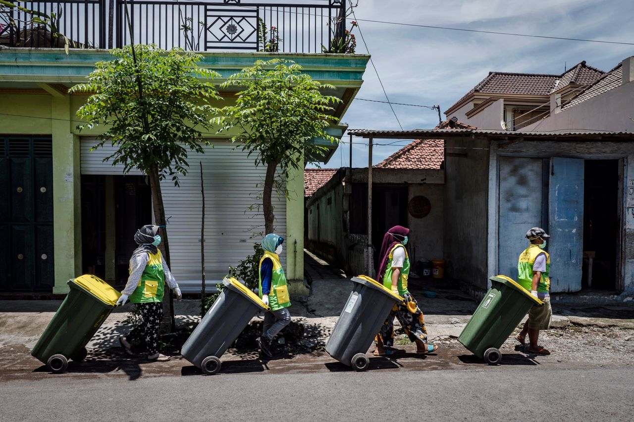 The Warriors of Waste go door to door collecting garbage from the community at Tembokrejo village in Muncar.