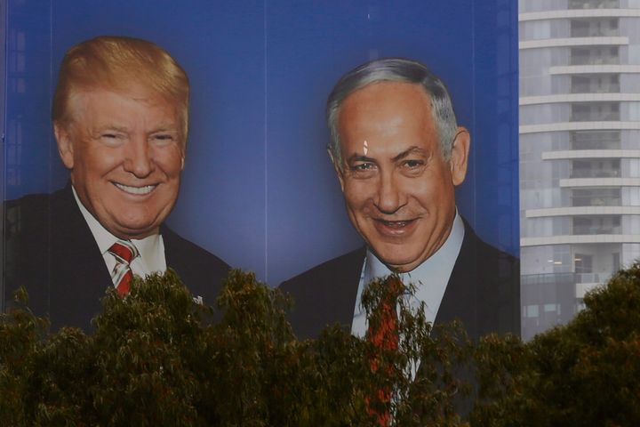 A billboard in Israel shows Donald Trump and Benjamin Netanyahu shaking hands. Netanyahu has used his friendship with Trump as proof of his influence.