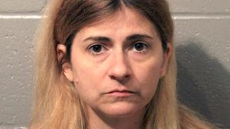 This Monday, April 8, 2019, booking photo provided by the Cleveland County Sheriff's Office shows 45-year-old Allison Christine Johnson of Norman, Ok., who is suspected of spray painting racist, anti-gay and anti-Semitic graffiti on Democratic Party offices in Norman and Oklahoma City. Court records indicate Johnson was charged in Cleveland County Monday with one felony and three misdemeanor counts of malicious injury to property and one misdemeanor count of malicious intimidation or harassment. (Cleveland County Sheriff's Office via AP)