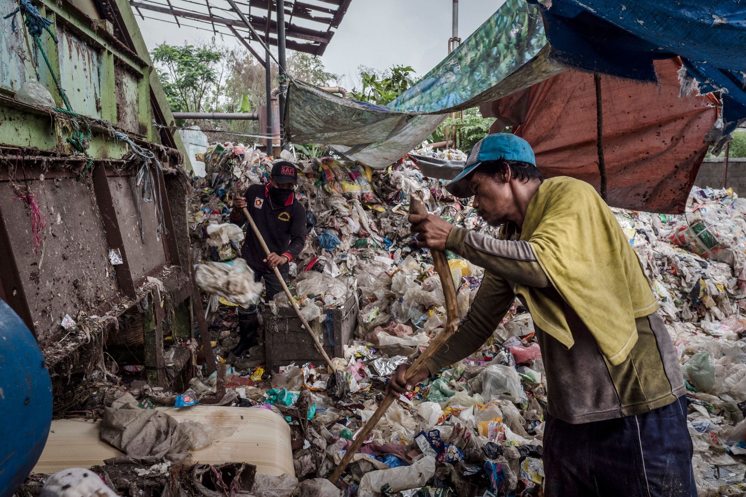 Workers sorting plastic to recycle at facility in Sidoarjo, an East Java city of 2.2 million.