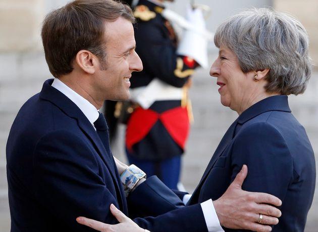 Emmanuel Macron and Theresa May meet in