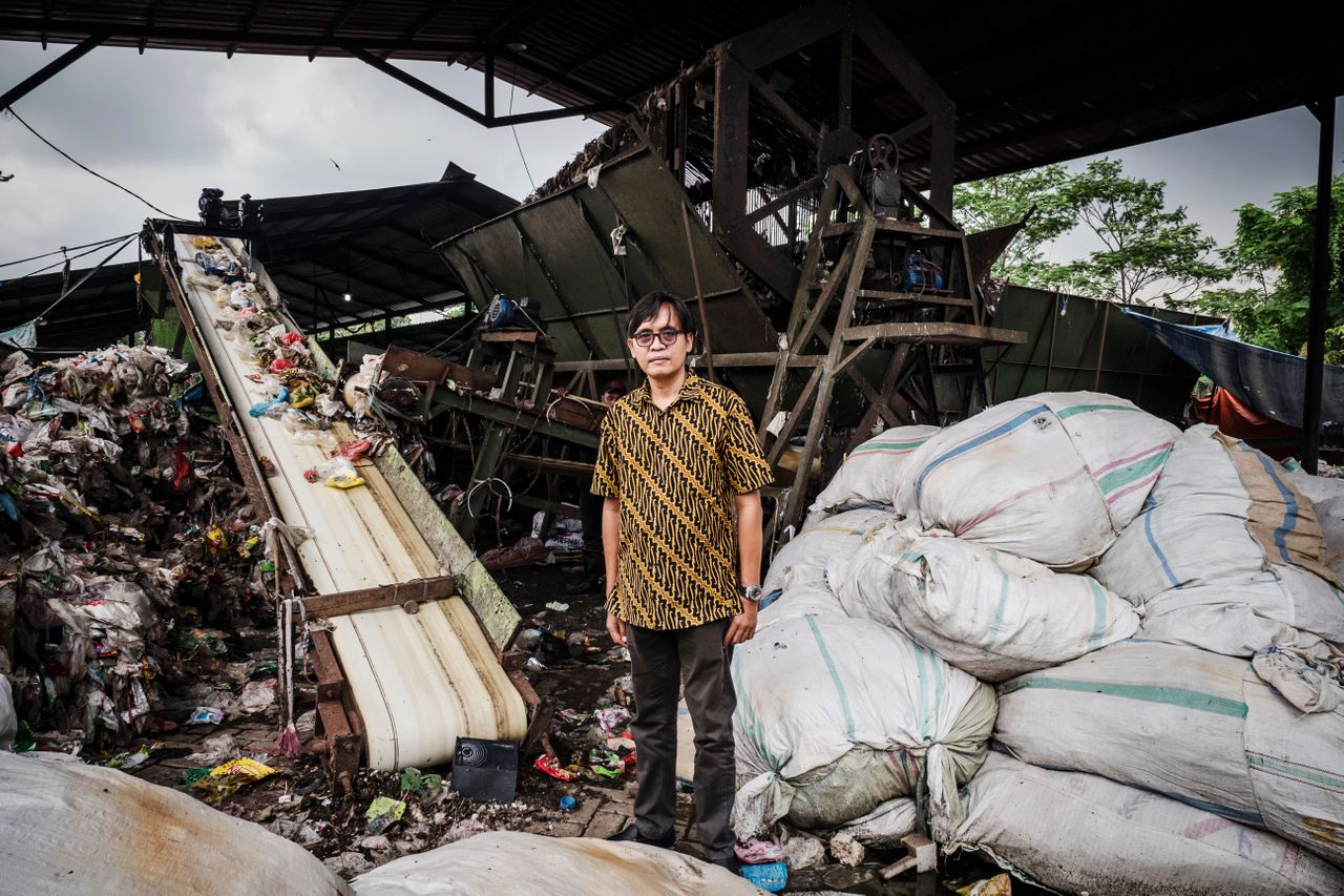 Bhima Diyanto, an ecologist and director of a waste management company, poses at a mechanical sorting center where neighborhood trash can be recycled.