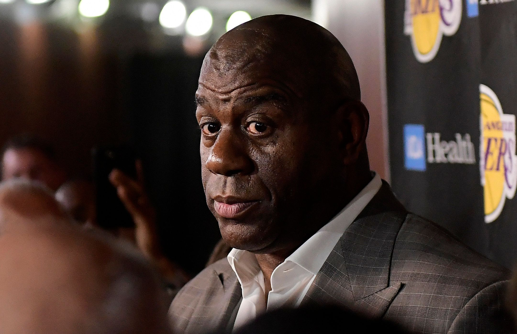 NBA media and fans alike were stunned Tuesday at Magic Johnson's abrupt resignation from the Lakers. (AP)