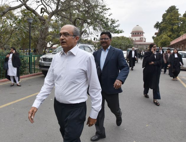 Senior lawyer Prashant Bhushan leaves after the hearing of Rafale case at Supreme Court, on March 14,...