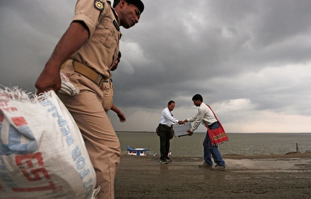 PHOTOS: Polling Officers Take Boats To Reach Assam's Remotest