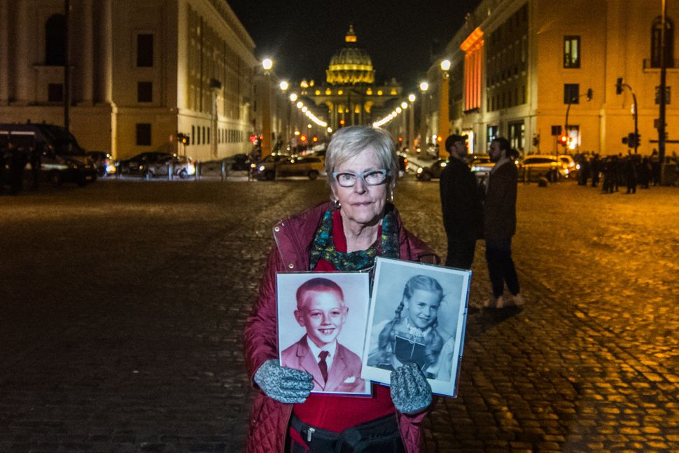 Mary Dispenza, an organizer with the Survivors Network of Those Abused by Priests, poses for a portrait at a vigil in Vatican