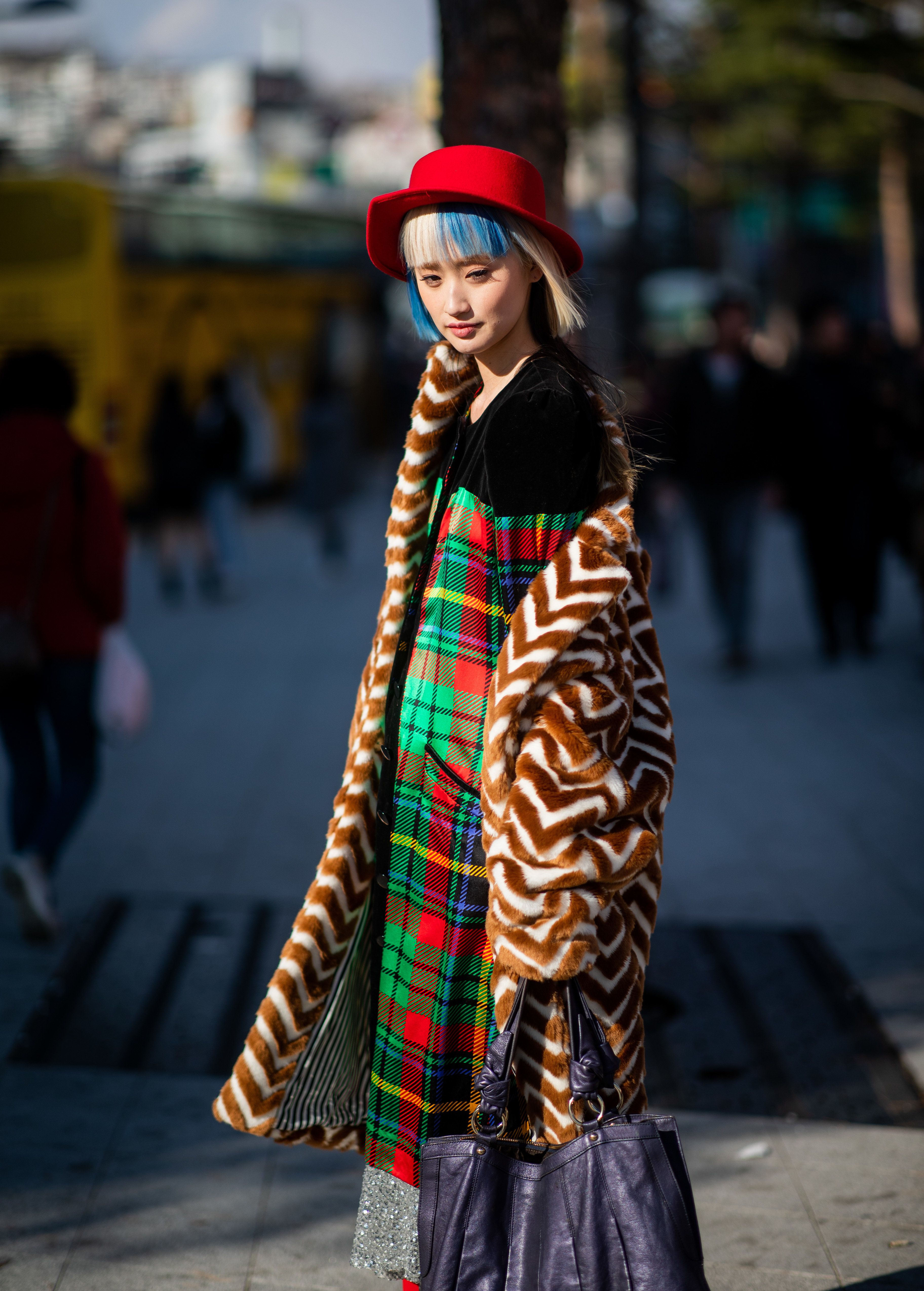 SEOUL, SOUTH KOREA - MARCH 23: A guest is seen wearing red hat, plaid dress at the Hera Seoul Fashion Week 2019 F/W at Dongdaemun Design Plaza at Dongdaemun Design Plaza on March 23, 2019 in Seoul, South Korea. (Photo by Christian Vierig/Getty Images)