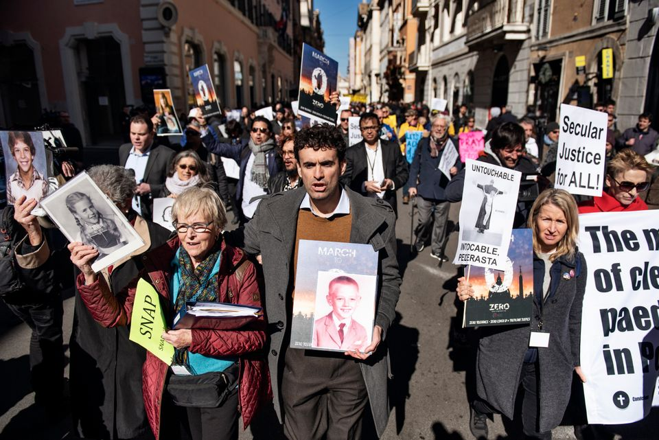 Survivors and activists protest in Rome on Feb. 23, 2019, as Catholic bishops from around the world convened...