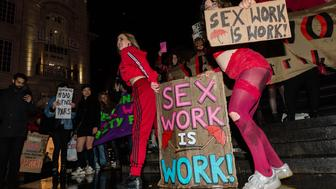 Exotic dancers perform in Piccadilly Circus in central London during a demonstration against discrimination of sex workers held on International Women's Day on 08 March, 2019. Hundreds of people took part in a protest march to demand full decriminalisation of sex work, ability to unionise, provide better working conditions and protection against violence experienced by sex workers. (Photo by WIktor Szymanowicz/NurPhoto via Getty Images)