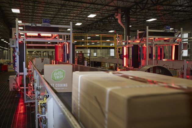 A HelloFresh package moves through an automated scanner at the FedEx Ground distribution center in Jersey...