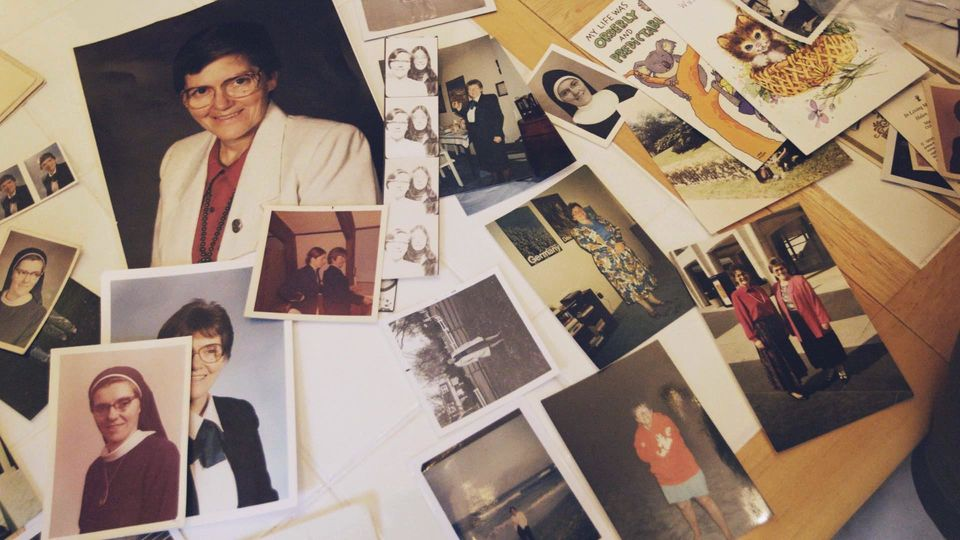 Photos of Sister Eileen Shaw are laid out on a table inside Trish Cahill's home in Lancaster,
