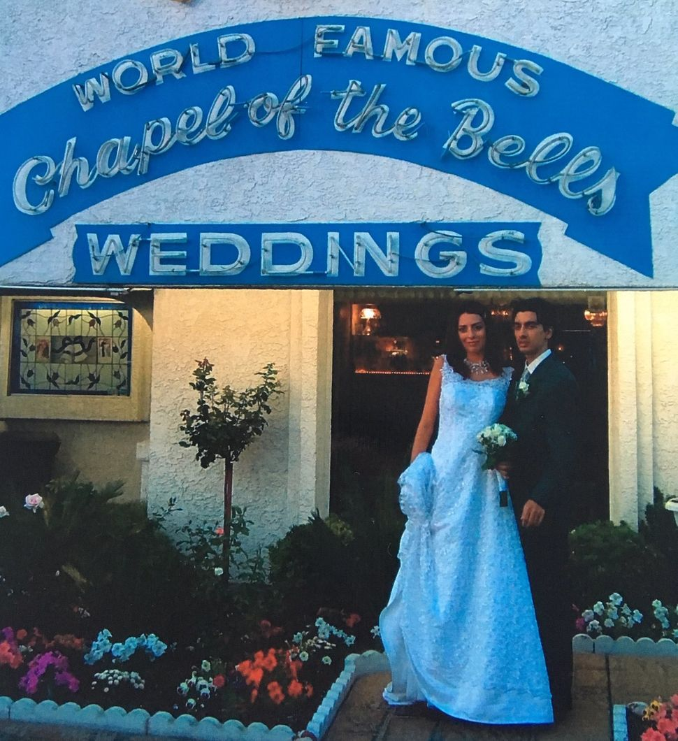Arianna and Steve in front of the Chapel of the Bells in Las Vegas on their wedding day, Oct. 31, 2003.