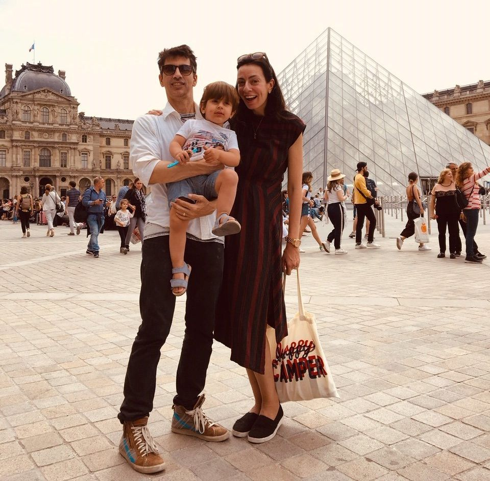 Arianna and Steve with their son, Theo, in Paris, spring 2018.