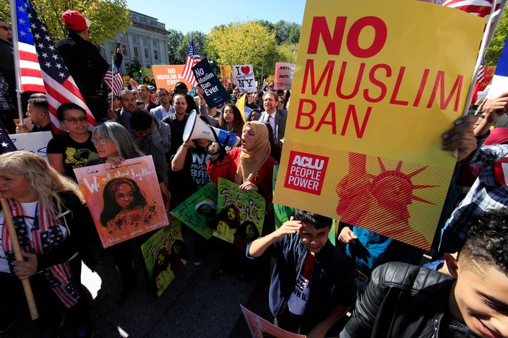 People rally against Trump's Muslim ban in Washington on Oct. 18, 2017.