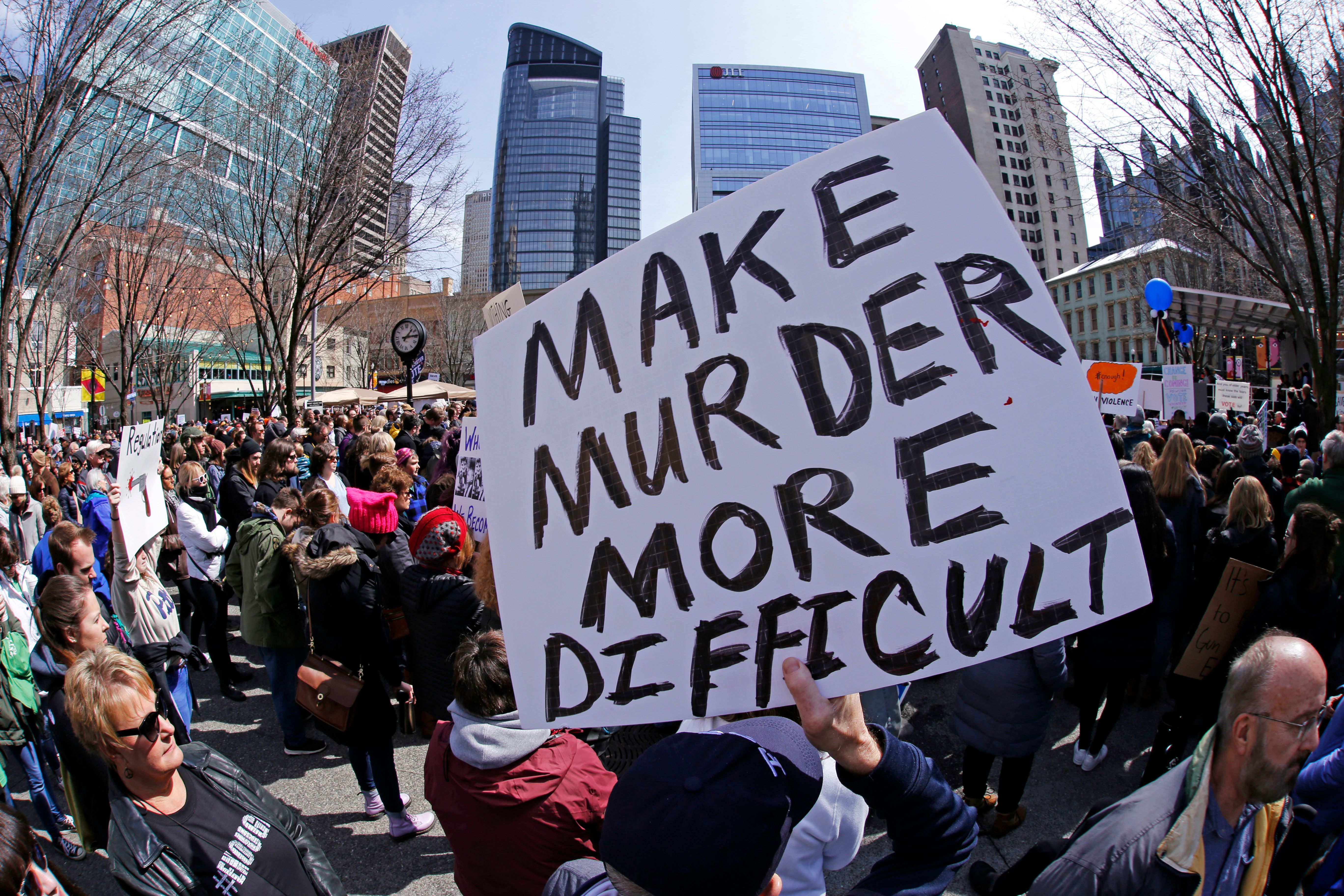 People hold signs during a gun control rally in Market Square in downtown Pittsburgh in March 2018.