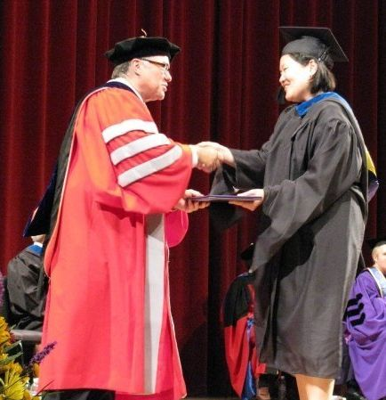 The author at her MBA graduation ceremony.