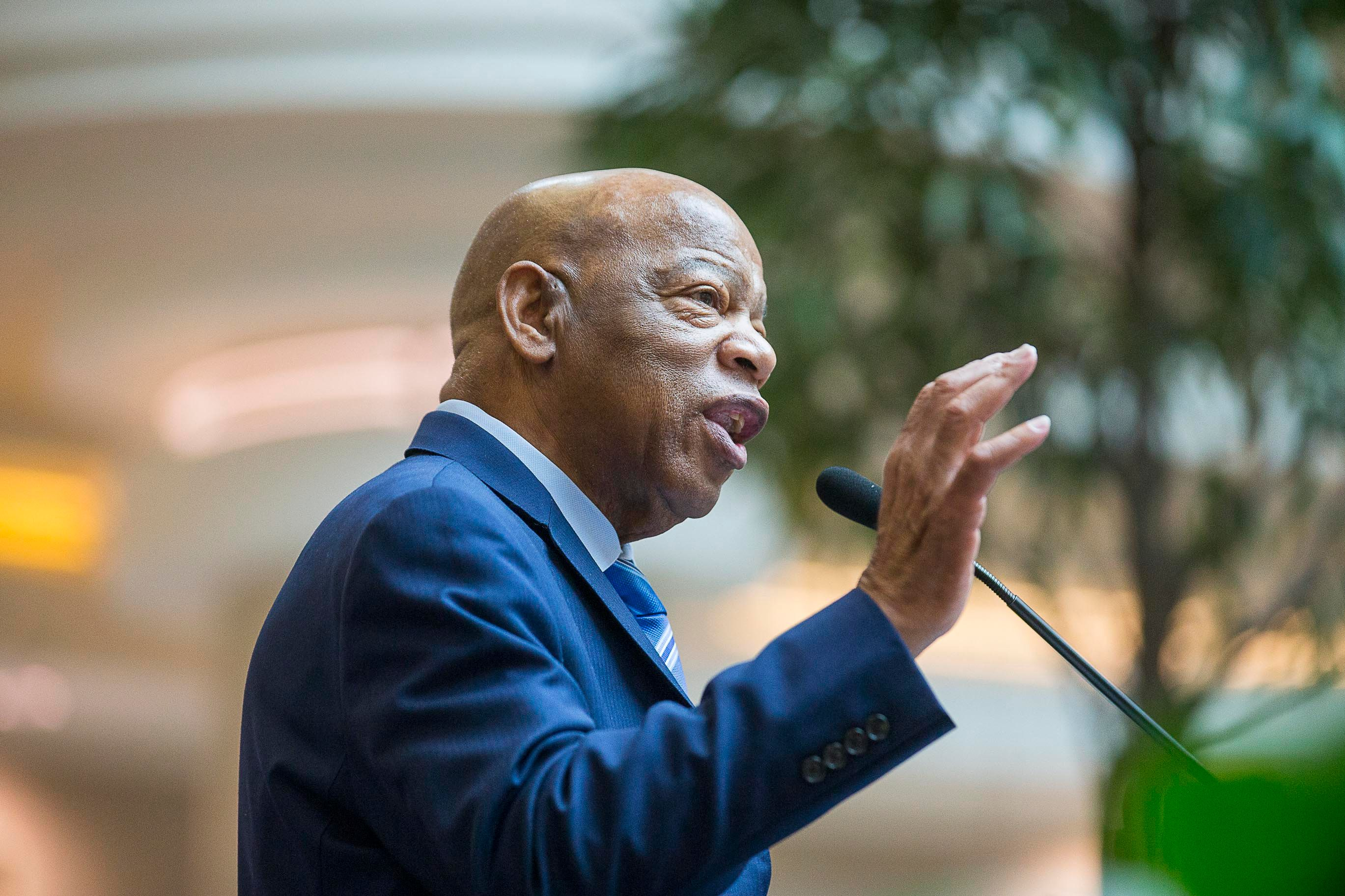 "Congressman John Lewis speaks during his art exhibit tribute in the atrium of the domestic terminal at Atlanta's Hartsfield Jackson International Airport, Monday, April 8, 2019. The art exhibit ""John Lewis-Good Trouble"" was unveiled Monday with historical artifacts, audio and visual installations and tributes to the congressman. (Alyssa Pointer/Atlanta Journal-Constitution via AP)"