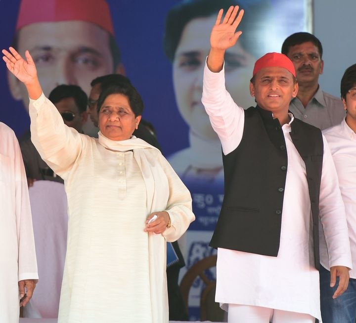 BSP president Mayawati and Samajwadi Party president Akhilesh Yadav wave at the first joint rally in Deoband on April 7, 2019.