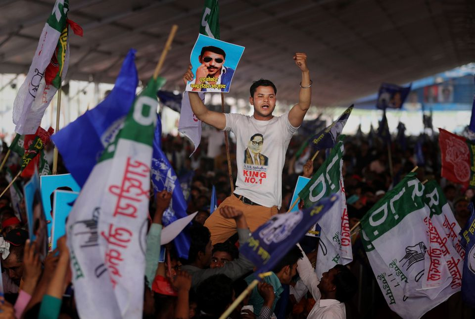 A participant displays a picture of Dalit leader Chandrasekhar Azad as supporters of BSP, SP and RLD...