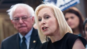 UNITED STATES - APRIL 10: Sens. Kirsten Gillibrand, D-N.Y., and Bernie Sanders, I-Vt., conduct an event to introduce the 'Medicare for All Act of 2019' in Dirksen Building on Wednesday, April 10, 2019. (Photo By Tom Williams/CQ Roll Call)