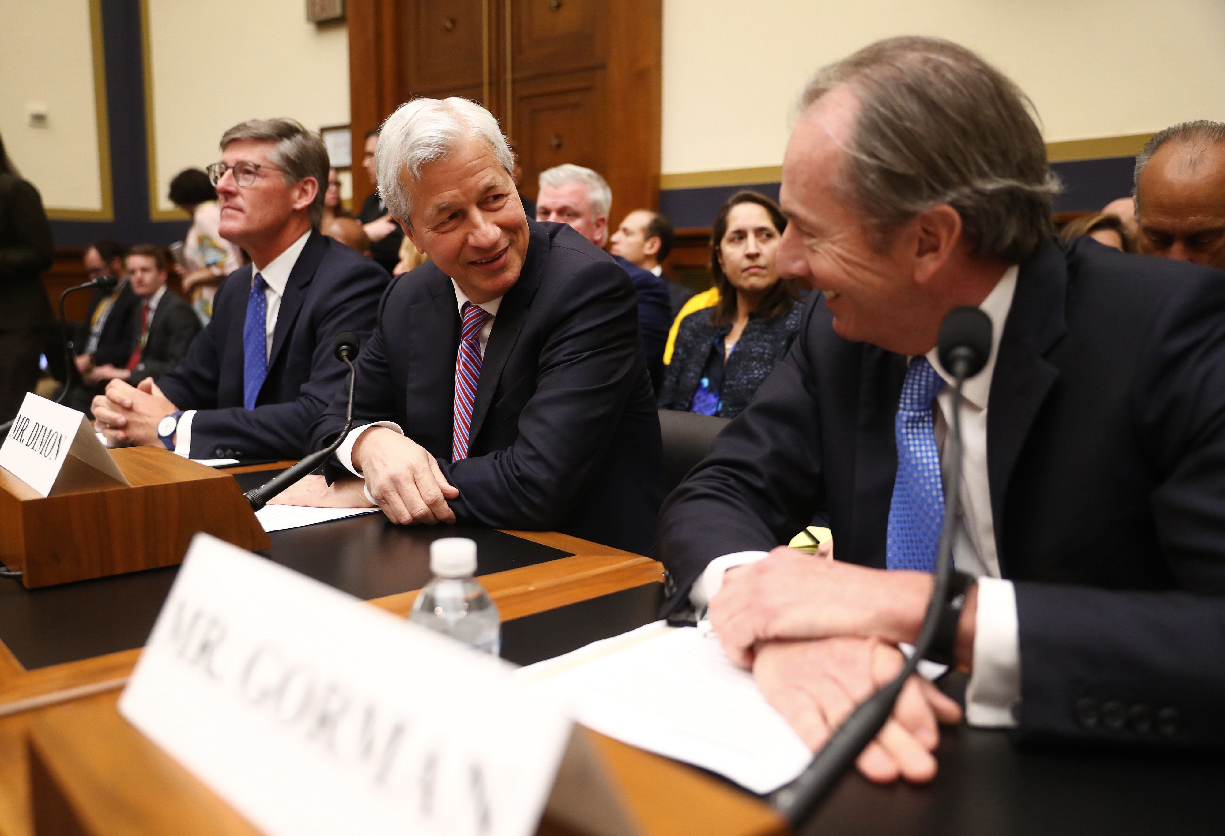 Jamie Dimon, chief executive officer of JPMorgan Chase & Co., center, speaks with James Gorman, chief executive officer of Morgan Stanley, right, before the start of a House Financial Services Committee hearing in Washington, D.C., U.S., on Wednesday, April 10, 2019. The chief executives of some of the U.S.'s biggest banks should get ready for hostility as they're about to serve as political-theater targets at a House committee hearing, analysts say. Photographer: Andrew Harrer/Bloomberg via Getty Images